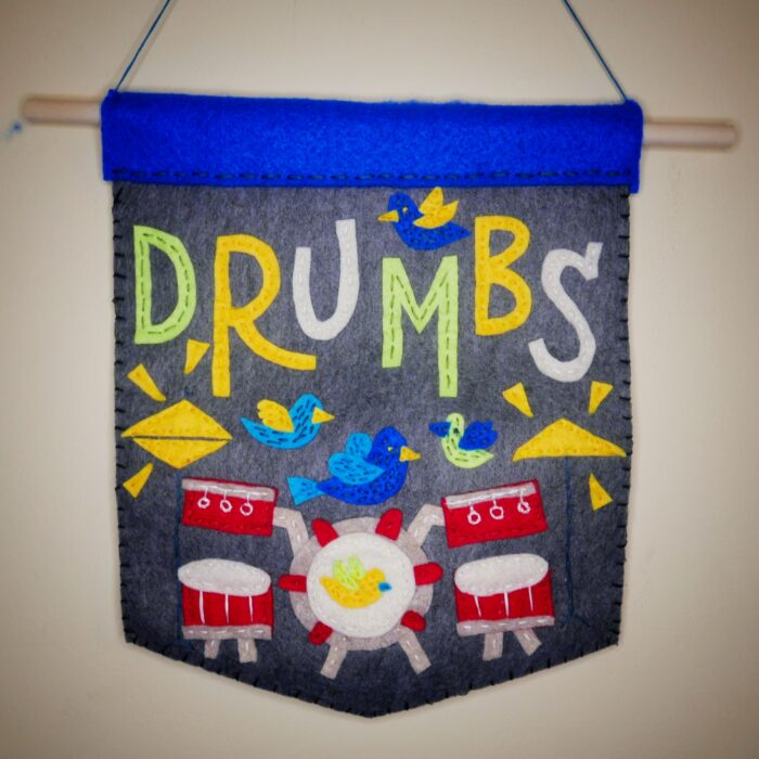 cover art for the DRUMBS single by Jesse Dangerously and Danny Miles, the drummer for July Talk